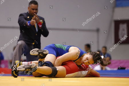 Canadian Michelle Fazzari (red) and Brazilian Lais Oliveira (blue) Compete in the Greco-roman Wrestling 60 Kg Category During the Pan American Sports Festival Held in Mexico City Mexico 16 July 2014 Mexico Mexico City