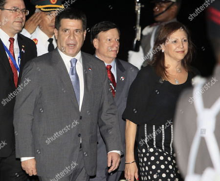 Paraguay's President Horacio Cartes Jara (l) Walks Next to Panamenian Vice Chancellor Mayra Arosemena (r) Upon His Arrival in Panama City Panama 16 October 2013 Cartes Jara Will Paticipate in the Iberoamerican Summit That Will Be Launched on 18 October 2013 and in Other Activities Related with the Summit Panama Panama City