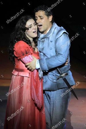 Peruvian Tenor Juan Diego Florez (r) As Romeo and Russian Soprano Venera Gimadieva (l) As Juliet Perform in the Opera 'Romeo and Juliet' at the Gran Teatro Nacional in Lima Peru 16 November 2014 Peru Lima