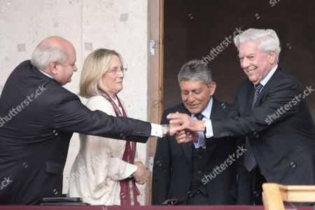 From Left to Righ Peru's Defense Minister Pedro Cateriano (l) Peru's Culture Minister Diana Alvarez-calder?n; Regional of Arequipa President Juan Manuel Guillen and Peruvian Writer Mario Vargas Llosa Participate in the Inauguration of a Extention of the Library That Has 2010 Nobel Prize Winner's Name in His Hometown of Arequipa South of Peru on 14 April 2014 Vargas Llosa Inaugurated the Extension of the Library to House His 'Most Dear and Close Friends ' the More Than 30 000 Books That Make Up His Personal Collection Peru Arequipa