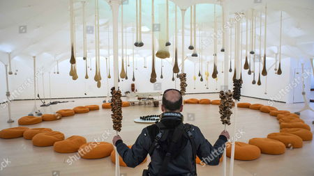 A Visitor Stands in Front of an Installation During the Media Preview of the Exhibition Entitled 'Ernesto Neto: the Body That Carries Me' by Brazilian Artist Ernesto Neto at the Guggengeim Bilbao Museum in Bilbao Spain 13 February 2014 the Display Running From 14 February to 18 May 2014 Features an Extensive Selection of Neto's Work From the End of the 1980s to the Present Some of Which Have Been Reconfigured Based on New Ideas and Wishes of the Artist As Well As the Museum's Specific Architecture Spain Bilbao