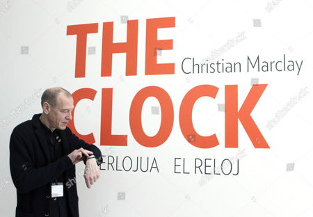 Us Artist Christian Marclay Looks at His Watch As He Presents 'Christian Marclay: the Clock' at Guggenheim Bilbao Museum in Bilbao Basque Country Northern Spain 06 March 2014 the Exhibition is Focused on Videoart Works and Installations Including the Clock a 24-hour Videomontage Spain Bilbao
