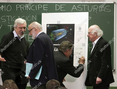Nobel Prize Laureates British Physicist Peter Higgs (r) and Belgian Physicist Francois Englert (2-l) and Representatives From the the European Organization For Nuclear Research (cern) Rolf Heuer (l) and Sergio Bertolucci (2-r) Sign a Poster After Discussion About the Higgs Boson Formula at the Science University in Oviedo Spain 24 October 2013 Both Physicists and the Cern Have Been Awarded with the Prince of Asturias Award For Technical & Scientific Research and Will Be Attending the Awarding Ceremony on 25 October 2013 Spain Oviedo