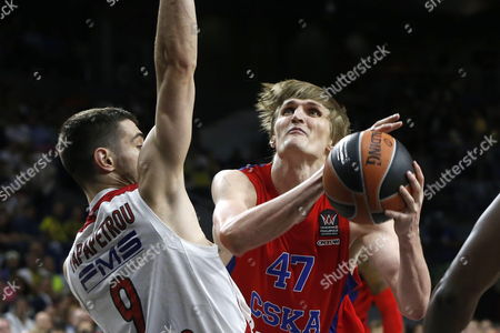 Cska Moscow's Player Andrei Kirilenko (r) Duels For the Ball with Olympiacos Piraeus' Player Ioannis Papatetrou (l) During the Semi Final Match of the Final Four of the Basketball Euroleague Played at Barclaycard Center Pavilion in Madrid Spain 15 May 2015 Spain Madrid