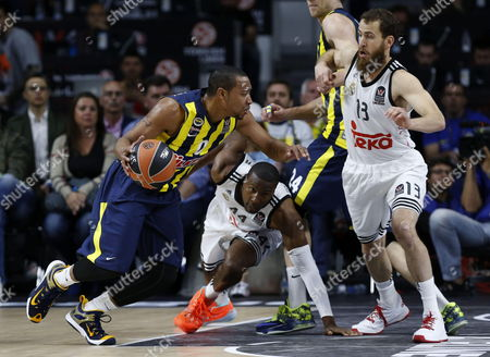 Real Madrid's Us Player Marcus Slaughter (c) and Sergio Rodriguez (r) Fight For the Ball with Us Player Andrew Goudelock (l) of Fenerbahce Ulker During the Semi Final Match of the Final Four of the Basketball Euroleague Played at Barclaycard Center Pavilion in Madrid Spain 15 May 2015 Spain Madrid
