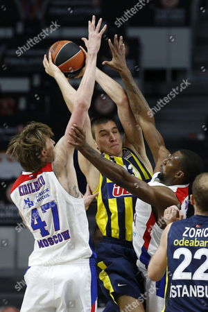 Fenerbahce Ulker Istanbul's Serbian Bogdan Bogdanovic (c) Struggles For the Ball Against Andrei Kirilenko (l) and Kyley Hines of Cska Moscow During Their Euroleague Final Four Third Place Game Held at the Barclaycard Center in Madrid Spain 17 May 2015 Spain Madrid
