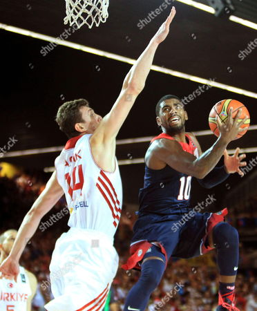Us Guard Kyrie Irving (r) Tries to Score Next to Turkish Center Omer Asik (l) During the Fiba Basketball World Cup Match Group C Match Between Turkey and the Usa at Bizkaia Arena (bec) Sports Pavilion in Bilbao Basque Country Northern Spain 31 August 2014 Spain Bilbao