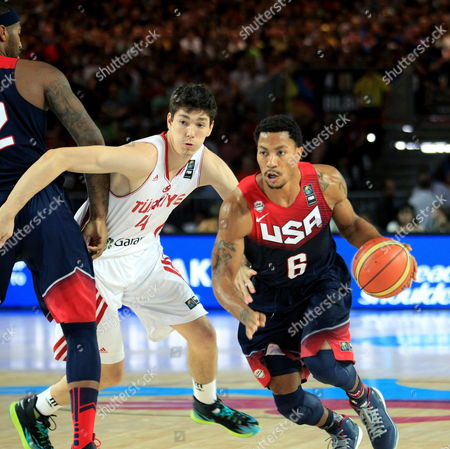 Us Guard Derrick Rose (r) in Action Against Turkish Cedi Osman (l) During the Fiba Basketball World Cup Match Group C Match Between Turkey and the Usa at Bizkaia Arena (bec) Sports Pavilion in Bilbao Basque Country Northern Spain 31 August 2014 Spain Bilbao