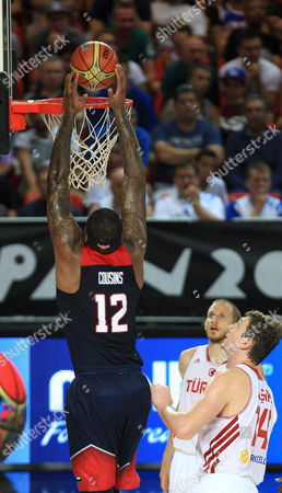 Demarcus Cousins (l) of the Us Dunks in Front of Omer Asik (r) of Turkey During the Fiba Basketball World Cup Match Group C Match Between Turkey and the Usa at Bizkaia Arena (bec) Sports Pavilion in Bilbao Basque Country Northern Spain 31 August 2014 Spain Bilbao