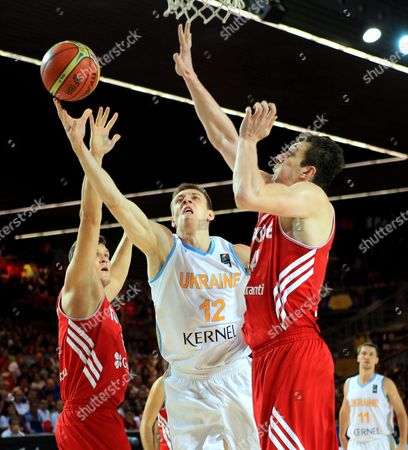 Turkey's Omer Asik (r) in Action Against Ukraine's Maxym Kornienko (c) During the Fiba Basketball World Cup Group C Match Between Turkey and Ukraine at the Bilbao Exhibition Center in Bilbao Northern Spain 02 September 2014 Spain Bilbao