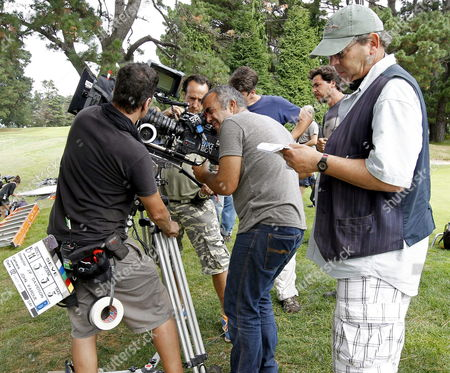 British Director John-paul Davidson (r) Looks at Some Sheets During the Shooting of His New Movie at Pedrena Golf Club in Pedrena Cantabria Spain 02 October 2013 the Movie Entitled 'Seve' on Spanish Golfer Severiano Ballesteros (1957-2011) is Scheduled For Release in April 2014 Spain Pedrena