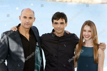 Stock Image of Spanish Film Maker Jorge Dorado (c) Pose with Us Actors/cast Members Taissa Farmiga (r) and Mark Strong (l) During the Presentation of His Film 'Mindscape' at the 46th Sitges International Fantastic Film Festival in Sitges Barcelona Province Catalonia Region North-eastern Spain Spain 13 October 2013 'Mindscape' Competes in the Official Section of the Festival Running From 11 to 20 October Spain Sitges