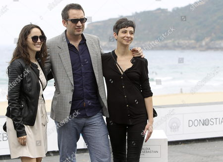 Chilean Director Cristian Jimenez (c) and Chilean Actresses/cast Members Ingrid Isensee (l) and Maria Siebald Pose For a Photocall of the Film 'La Voz En Off' During the 62nd Edition of San Sebastian International Film Festival in San Sebastian City Basque Country Northern Spain 23 September 2014 62th San Sebastian International Film Festival Runs From 19 to 27 September Spain San Sebastian