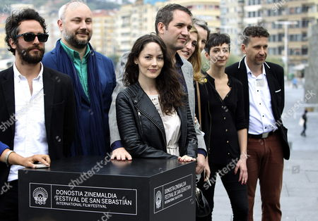 Chilean Film Director Cristian Jimenez (c) Poses with Cast Members and Members of the Production Team During the Photocall of the Film 'La Voz En Off' During the 62nd Edition of San Sebastian International Film Festival in San Sebastian City Basque Country Northern Spain 23 September 2014 62th San Sebastian International Film Festival Runs From 19 to 27 September Spain San Sebastian