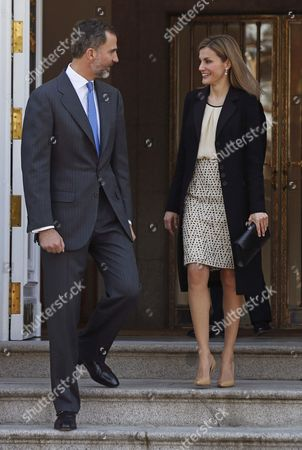 Spain's King Felipe Vi (l) and Queen Letizia Look Each Other at the Front Door of the Palace of La Zarzuela Before the Arrival of Colombian President Juan Manuel Santos and His Wife Maria Clemencia Rodriguez De Santos For an Official Luncheon at the Palace of La Zarzuela in Madrid Spain 01 March 2015 Santos is on a Three-day Long Visit to Spain Spain Madrid