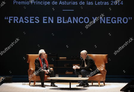 Irish Writer John Banville (l) and Argentinian Writer Rodrigo Fresan (r) Chat During a Conference Entittle 'Sentences in Black and White' at the Jovellanos Theatre in Oviedo Northern Spain 22 October 2014 Banville is in the Spanish City to Attend the 2014 Prince of Asturias Awards Ceremony on Next 24 October Banville Won 2014 Prince of Asturias Award For Literature For His 'Smart Deep and Original Fictional Creation' Spain Oviedo