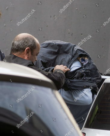 Stock Image of One of the Two Spanish Brothers (r) Accused of the Killing of Dutch Man Martin Verfondern is Taken Into Custody in a Local Court in O Barco De Valdeorras Near Oursense City in the North-western Province of Galicia Spain 02 December 2014 the Suspects Julio Aged 51 and Juan Carlos Rodriguez Gonzalez 47 Have Confessed to Spanish Civil Guard the Responsability of the Murder of Dutch Citizen Martin Verfonderm Missing Since January 2010 and Are to Give Evidences at Court Spain O Barco De Valdeorras (ourense)