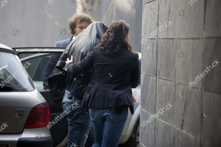 Stock Photo of One of the Two Spanish Brothers (l) Accused of the Killing of Dutch Man Martin Verfondern is Taken Into Custody in a Local Court in O Barco De Valdeorras Near Oursense City in the North-western Province of Galicia Spain 02 December 2014 the Suspects Julio Aged 51 and Juan Carlos Rodriguez Gonzalez 47 Have Confessed to Spanish Civil Guard the Responsability of the Murder of Dutch Citizen Martin Verfonderm Missing Since January 2010 and Are to Give Evidences at Court Spain O Barco De Valdeorras (ourense)