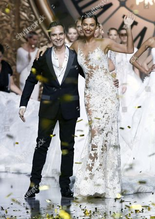 A Pictuer Made Available on 09 May 2015 Shows French Designer Herve Moreau (l) Appears on the Catwalk with Russian Model Irina Shayk (r) at the End of the Presentation of His Collection For Spanish Label Pronovias During the Gaudi Novias Barcelona Bridal Week in Barcelona Spain 08 May 2015 the Fashion Event Ended on 08 May Spain Barcelona