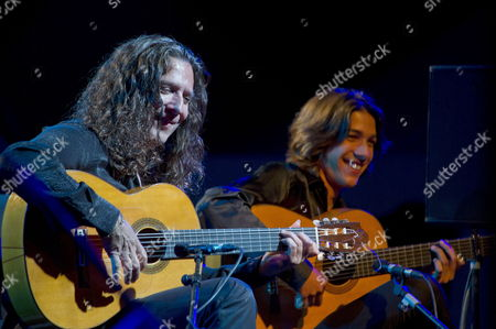 Spanish Flamenco Guitarist Tomatito (l) and His Son Jose Israel Perform on Stage During the Granada Dance and Music International Festival at Alhambra's Aljibes Playground in Granada Southern Spain 09 July 2014 Spain Granada