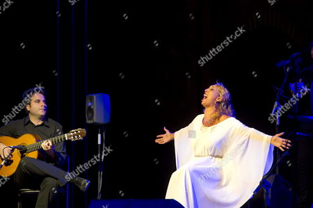 Spanish Flamenco Singer Esperanza Fernandez (r) Together with Guitarist Eduardo Trassierra (l) Performs on Stage During a Tribute to Portuguese Writer Jose Saramago at Aljibes Courtyard in La Alhambra Includes in Granada?s Music and Dance International Festival on 25 June 2014 Spain Granada