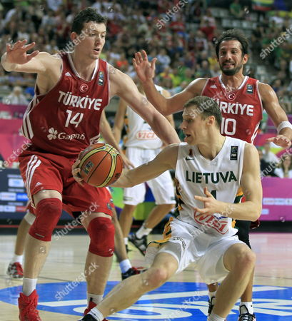 Kerem Tunceri (r) and Omer Asik (l) of Turkey in Action Against Martynas Pocius (c) of Lithuania During the Fiba Basketball World Cup Quarter Final Match Between Lithuania and Turkey at Palau Sant Jordi Sports Pavilion in Barcelona Catalonia North-eastern Spain 09 September 2014 Spain Barcelona