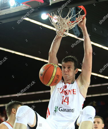 Turkish Player Omer Asik Scores a Basket During the Fiba Basketball World Cup Match Group C Match Between Turkey and Finland Played at Bizkaia Arena (bec) Pavilion in Bilbao Northern Spain 03 September 2014 Spain Bilbao