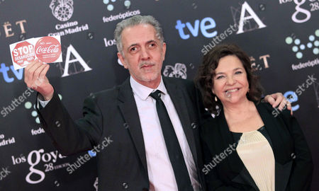 Spanish Film Director Fernando Trueba (l) and His Wife Cristina Huete (r) Pose For the Media During His Arrival at the 28th Goya Awards Awarding Ceremony in Madrid Spain 09 February 2014 the Goya Awards Are the Main National Annual Film Awards in Spain Trueba Showed Protest Sticker Solidarizing with Demonstrators Outside who Protest About Job Cuts by Coca Cola Company Spain Madrid