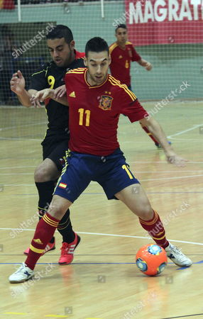 Stock Picture of Spanish Indoor Soccer Player Sergio (r) Fights For the Ball with Belgian Indoor Soccer Player Bezerra Do Carmo (l Rear) During Their Friendly Match Played at Guillermo Molina Pavilion in Ceuta the Spanish Enclave in Northern Africa 23 September 2013 Spain Ceuta