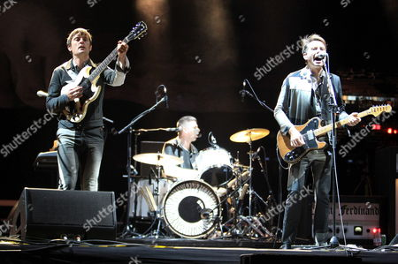 Stock Image of Scottish Singer and Guitarist Alex Kapranos (l) Drummer Paul Robert Nester Thomson (c) and Guitarist Nick Mccarthy (l) of the Scottish Indie Rock Band Franz Ferdinand Perform on Stage at Rock Bbk Live in Bilbao 10 July 2014 Spain Bilbao