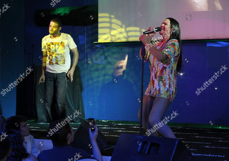 Portuguese Singer Katia Aveiro (r) Sister of Real Madrid's Striker Cristiano Ronaldo Performs on Stage During the Presentation of Her Album 'Boom Sem Parar' Concert in Madrid Central Spain 18 September 2013 Spain Madrid