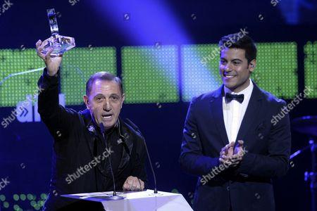 Venezuelan Singer Franco De Vita (l) Acknowledges His 'Dial' Award During the Cadena Dial Awards 2013 Ceremony Held in Valladolid Spain 07 March 2014 Spain Valladolid