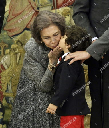 Spain's Queen Sofia (l) Gives a Kiss to the Son of Spanish Paralympic Swimmer Maria Teresa Perales (not Pictured) During an Honoring Ceremony at the Palace of Zarzuela in Madrid Spain 01 April 2014 Perales Received the Great Cross of Sports Merit Spain Madrid