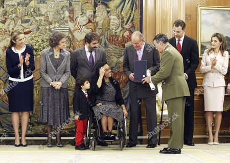 Spain's King Juan Carlos (4-r) Hands the Great Cross of Sports Merit to Spanish Paralympic Swimmer Maria Teresa Perales (c) in Presence of Queen Sofia (2-r) Crown Princes Felipe (2-r) and Letizia (r) and Princess Elena (l) During an Honoring Ceremony at the Palace of Zarzuela in Madrid Spain 01 April 2014 Perales Received the Great Cross of Sports Merit Spain Madrid