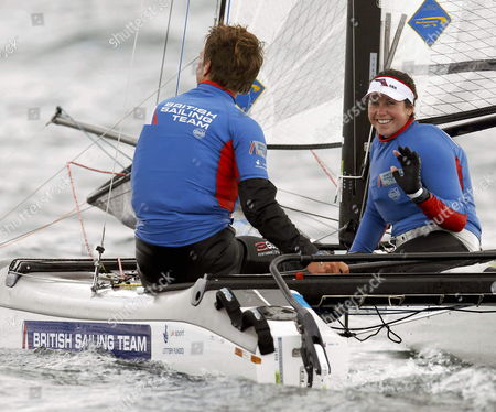 Stock Photo of British Competitors Ben Saxton (l) and Hannah Diamond (r) React During the Nacra Class Competition of the Santander City Trophy the Test Event For the Santander 2014 Isaf Sailing World Championships in Santander Northern Spain 11 September 2013 Spain Santander