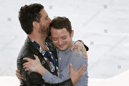 Spanish Director Eugenio Mira (l) Hugs Us Actor/cast Meber Elijah Wood at a Photocall For 'Grand Piano' During the Sitges International Fantastic Film Festival in Sitges Outside Barcelona Spain 11 October 2013 the Festival Runs From 11 to 20 October Spain Sitges