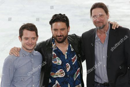 Spanish Director Eugenio Mira (c) Poses with Us Actors/cast Members Elijah Wood (l) and Don Mcmanus at a Photocall For 'Grand Piano' During the Sitges International Fantastic Film Festival in Sitges Outside Barcelona Spain 11 October 2013 the Festival Runs From 11 to 20 October Spain Sitges