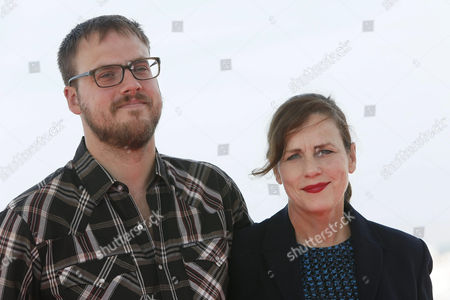 Stock Image of Us Director Jim Mickle (l) and Producer Linda Moran Pose For Photographers During the Presentation of Their Movie 'Cold in July' at the 47th Annual Sitges International Fantastic Film Festival in Sitges Outside Barcelona Spain 07 October 2014 the Festival Runs From 03 to 12 October Spain Sitges (barcelona)