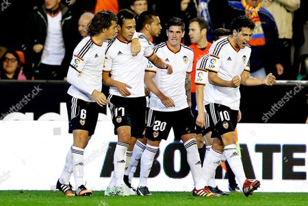 Valencia's Striker Rodrigo Moreno Machado (2-l) Celebrates with His Teammates After Scoring the 4-4 Equalizer During the Spanish King's Cup Fourth Round Second Leg Soccer Match Between Valencia Cf and Rayo Vallecano at Mestalla Stadium in Valencia Eastern Spain 16 December 2014 Spain Valencia