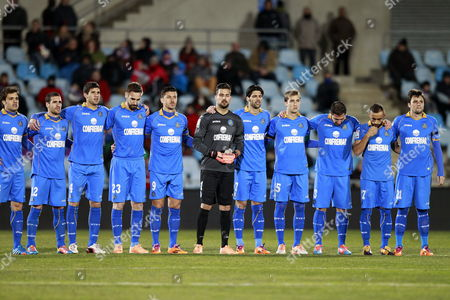 Getafe's Players Observe a Minute of Silence in Honour of Late Spanish Former Coach Luis Aragones Before the Spanish Primera Division Match Between Getafe and Valladolid at Ciudad De Valencia Stadium in Getafe Outside Madrid Spain 01 February 2014 Aragones who was Head Coach of Several Spanish Teams Including Fc Barcelona Atletico Madrid Real Mallorca and the Spanish National Soccer Team Died at the Age of 75 Early 01 February 2014 at a Madrid Hospital After Suffering a Long Illness Spain Getafe