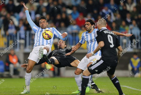Real Madrid's Portuguses Striker Cristiano Ronaldo (2l) Tries to Score Next to Defenders Weligton (l) and Sergio Sanchez (2r) of Malaga Fc During Their Primera Division Soccer Match Played at La Rosaleda Stadium in Malaga Andalusia Spain on 29 November 2014 Spain Malaga