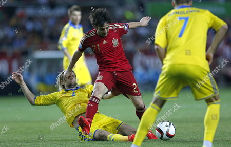 Spanish Midfielder David Silva (c) Fights For the Ball with Anatoliy Tymoshchuk (l) of Ukrania During Their Uefa Euro 2016 Qualification Soccer Match Between Spain and Ukrania Played at Sanchez Pijuan Stadium in Seville Andalusia Spain on 27 March 2015 Spain Sevilla