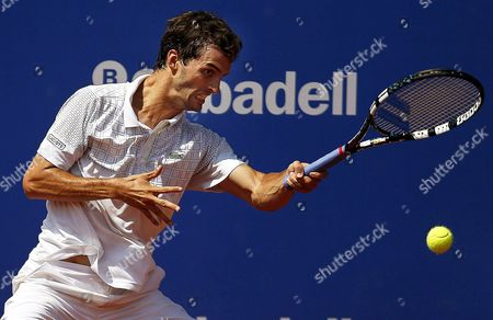 Albert Ramos of Spain Returns the Ball to Nikolay Davydenko of Russia During Their First Round Match of the Conde De Godo Barcelona Open Tennis Tournament in the Real Club Tennis Center in Barcelona North-eastern Spain 22 April 2014 Spain Barcelona