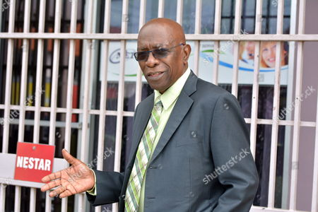 Former Fifa Vice President Austin Jack Warner Gestures As He Leaves the Office of the Sunshine Newspaper Which He Owns in Arouca East Trinidad on May 27 2015 Warner who was Also the Former President of Concacaf was Named Among Current and Former Fifa Officials Indicted by the United States Justice Department Following a Three-year Investigation Into in a Corruption and Bribery Scandal Trinidad and Tobago Arouca
