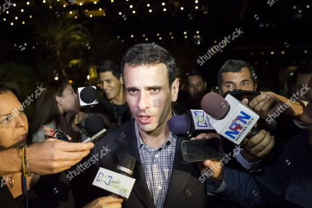 Stock Photo of Venezuelan Former Opposition Presidential Candidate Henrique Capriles Radonski Speaks to the Press at the Melia Hotel in Caracas Venezuela 07 April 2014 the Representatives From the Union of South American Nations (unasur) who Are on a Second Visit to the Country in Order to Contribute to the Talks Met on 07 April with Capriles and Other Governors in Opposition to the Government of Nicolas Maduro Venezuela Caracas