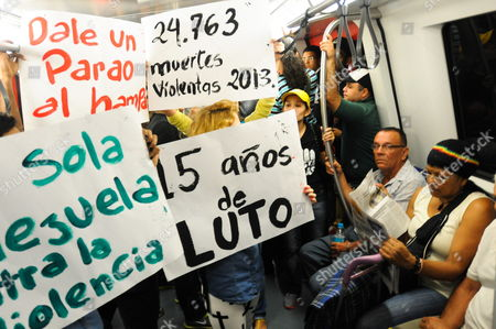 Stock Image of Venezuelan Artists and Citizens Hold Placards Reading 'Stop the Crime' '24 763 Violent Deaths in 2013' and '15 Years of Mourning' During a Protest Against the Violence Due the Recent Crime of Former Miss Venezuela Monica Spear Inside a Metro Wagon in Caracas Venezuela 08 January 2014 Actress and Beauty Queen Monica Spear Mootz a Former Miss Venezuela is Dead After a Suspected Robbery Venezuelan Media Reported 07 January Spear Mootz was Shot on the Highway Between Puerto Cabello and Valencia the Daily El Universal Said Citing Police Her Husband Irish Businessman Henry Thomas Barry was Also Killed in the Attack Late 06 January Venezuela Caracas