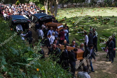 People Carry the Coffins of Former Venezuelan Actress Monica Spear (front) and Her Husband Henry Thomas Berry (back) During Their Funeral at Cementerio Del Este in Caracas Venezuela 10 January 2014 Venezuelan Authorities Have Announced They Are Looking For Another Four Suspects in the Homicide Case of Spear and Berry Venezuela Caracas