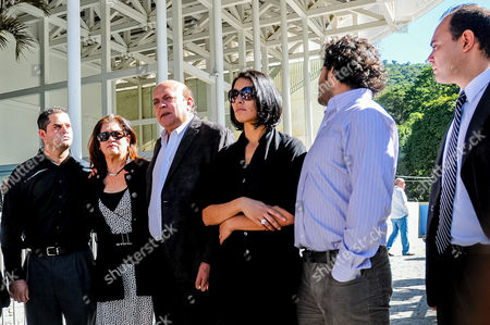 Stock Photo of (l-r) Relatives of Actress Monica Spear Javier Spear (brother) Enna Smoth (mother) Javier Spear (father) Carolina Spear (sister) Ricardo Spear (brother) Attend Her and Her Husband Henry Thomas Berry's Funeral at the Funeral Home Cementerio Del Este in Caracas Venezuela 09 January 2013 Venezuelan Authorities Have Announced They Are Looking For Another Four Suspects in the Homicide of Spear and Berry Seven More Suspects Are Under Arrest For This Crime Venezuela Caracas