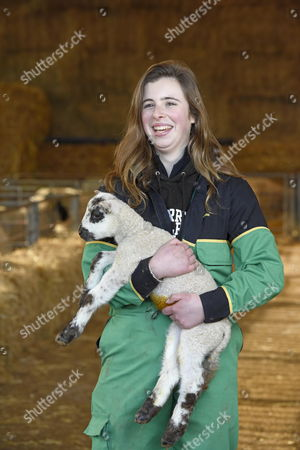 Student Emily Smith with a lamb at Sparsholt College, near Winchester