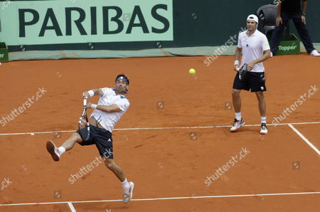 Italy's Simone Bolelli (r) and Fabio Fognini (l) in Action Against Argentina's Eduardo Schwank and Horacio Zeballos During Their Doubles Match For the Davis Cup World Group Tie Between Argentina and Italy in Mar Del Plata Argentina 01 February 2014 Argentina Mar Del Plata